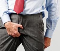 睾丸炎的症状有哪些?是怎么引起的?能自愈吗?